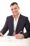 Handsome businessman writing in notebook Royalty Free Stock Photography