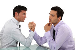 Handsome businessmen arm wrestling Stock Photo