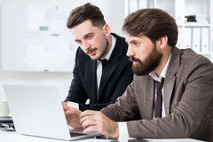 Handsome businesspeople discussing project Stock Photo