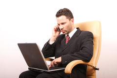 Handsome calling businessman with laptop 2 Royalty Free Stock Photo
