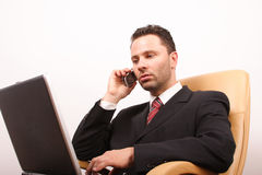Handsome calling businessman with laptop Royalty Free Stock Images