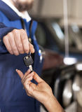 Handsome car mecanic giving back the keys Stock Photography