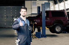 Handsome car mechanic Stock Images