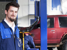 Handsome car mechanic Royalty Free Stock Images