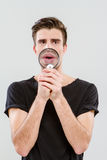 Handsome carismatic man using magnifying glass Stock Photo