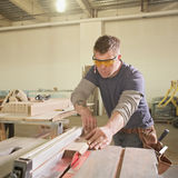 Carpenter. Handsome carpenter man at work Royalty Free Stock Photography