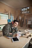 Handsome Carpenter Working On Blueprint In Royalty Free Stock Photography