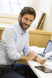 Handsome casual business man working on computer in modern offic Stock Photo