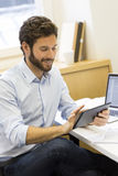 Handsome casual business man working on computer in modern offic Royalty Free Stock Photo