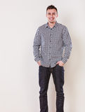 Handsome casual fashion man guy in plaid shirt. Stock Photos