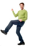 Handsome casual guy dancing Royalty Free Stock Image