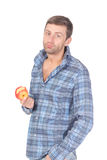 Handsome casual man eat apple Royalty Free Stock Image