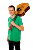 Handsome casual man with guitar on shoulders Royalty Free Stock Photo