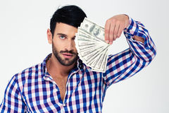 Handsome casual man holding bills of dollar Stock Photos