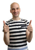 Handsome casual man holds his thumbs up Royalty Free Stock Photos