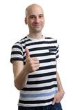 Handsome casual man holds his thumbs up Stock Photo