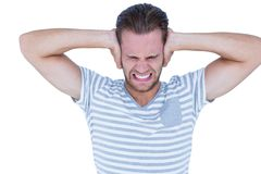 Handsome casual man screaming with hand on ears Stock Photography