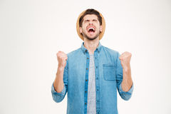 Handsome casual man showing excitement isolated on white background Stock Image