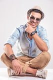 Handsome casual man sitting and smiling Royalty Free Stock Photography