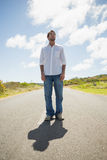 Handsome casual man standing on a road Royalty Free Stock Photography