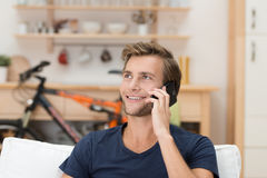 Handsome casual man talking on a mobile Royalty Free Stock Images
