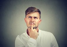 Serious young man reflecting on problem royalty free stock images