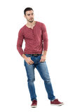 Handsome casual stylish young man with thumbs in pockets looking at camera. Royalty Free Stock Photography
