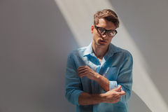 Handsome casual young man fixing his sleeve Royalty Free Stock Photo