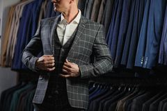 Handsome caucasian businessman dressed in the suit in suit shop Stock Photography