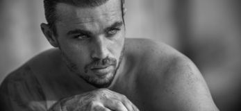 Handsome Caucasian Male Model posing in black and white portrait stock photos
