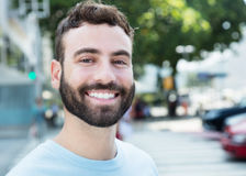 Handsome caucasian man with beard. Outdoor in city Stock Photos