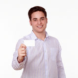 Handsome caucasian man holding blank card Royalty Free Stock Images