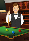Handsome caucasian man holding cue stick Stock Photography