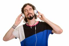 Handsome Caucasian man listening to music with eyes closed. Isolated against white background royalty free stock images