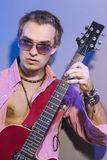 Handsome Caucasian Man Posing with Guitar. Stock Photos