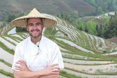 Handsome Caucasian tourist in Asian rice terraces stock photo