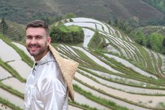 Handsome Caucasian tourist in Asian rice terraces royalty free stock photo