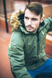 Handsome caucasian young man in casual clothes in urban environm Royalty Free Stock Photography