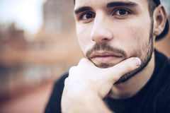 Handsome caucasian young man in casual clothes in urban environm Stock Photography