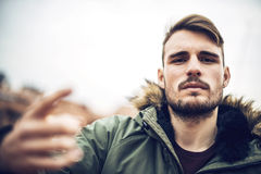 Handsome caucasian young man in casual clothes in urban environm Stock Images