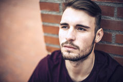 Handsome caucasian young man in casual clothes in urban environm Royalty Free Stock Photos