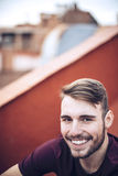 Handsome caucasian young man in casual clothes in urban environm Royalty Free Stock Images