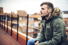 Handsome caucasian young man in casual clothes in urban environm Stock Image