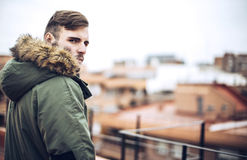 Handsome caucasian young man in casual clothes in urban environm Stock Photos
