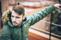Handsome caucasian young man in casual clothes in urban environm Royalty Free Stock Photo