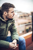 Handsome caucasian young man in casual clothes in urban environm Royalty Free Stock Image