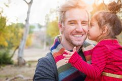 Handsome Caucasian Young Man with Mixed Race Baby Girl Outdoors. Handsome Caucasian Young Man with a Mixed Race Baby Girl Outdoors stock image