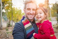 Handsome Caucasian Young Man with Mixed Race Baby Girl Outdoors. Caucasian Young Man with Mixed Race Baby Girl Outdoors stock images