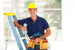 Cctv guy. Handsome cctv guy with tools and security camera royalty free stock photos