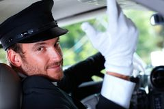 Handsome chauffeur in elegant car Royalty Free Stock Image
